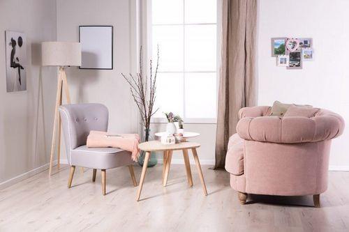 Особенности и правила выбора мягкого кресла для гостиной